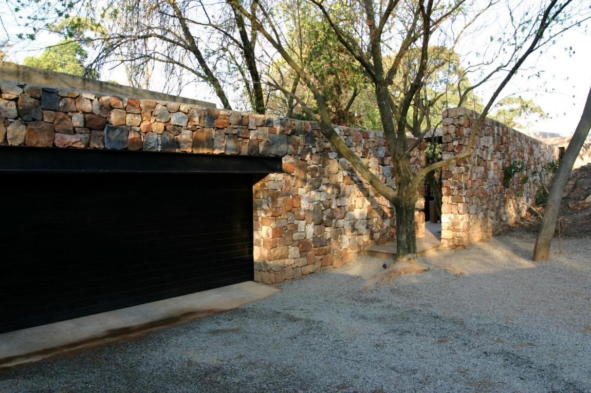 Дом на склоне: проекты и фото стильного каменного особняка