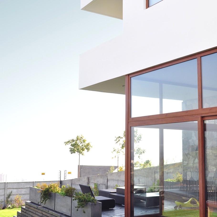 Дома со стеклянным фасадом: оригинальный Donoso Smith House в Чили