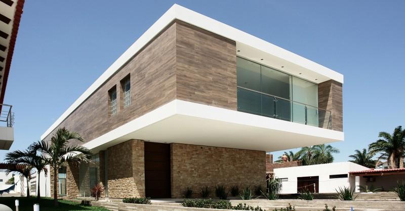Дома из камня и дерева: роскошный консольный C House в Боливии