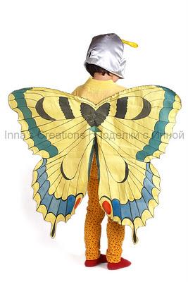 Мне костюм бабочки с одной стороны напоминает. костюм феи.