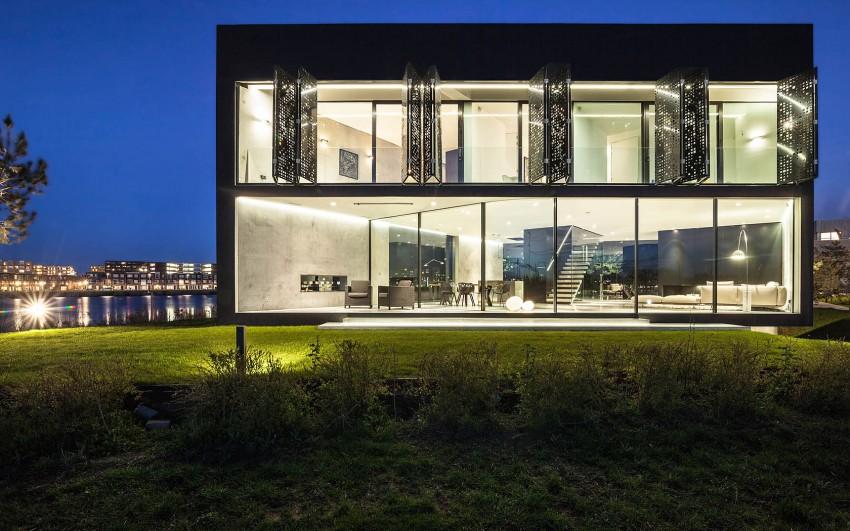 Проект дома на склоне холма: необычная геометрия Kavel 1