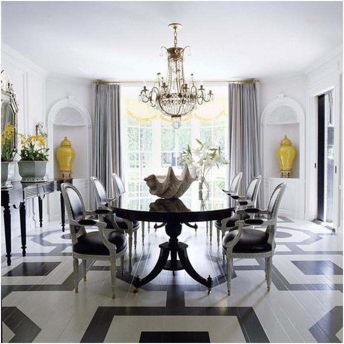 Черно-белый интерьер столовой разбавлен желтыми аксессуарами