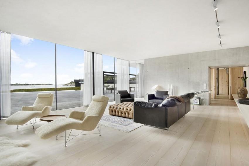 Минималистский проект монолитного дома со стеклянными стенами