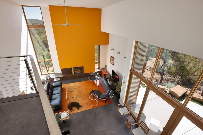 Минималистский проект загородного дома на склоне