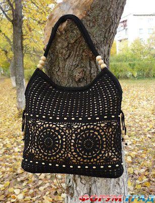черная ажурная сумка.