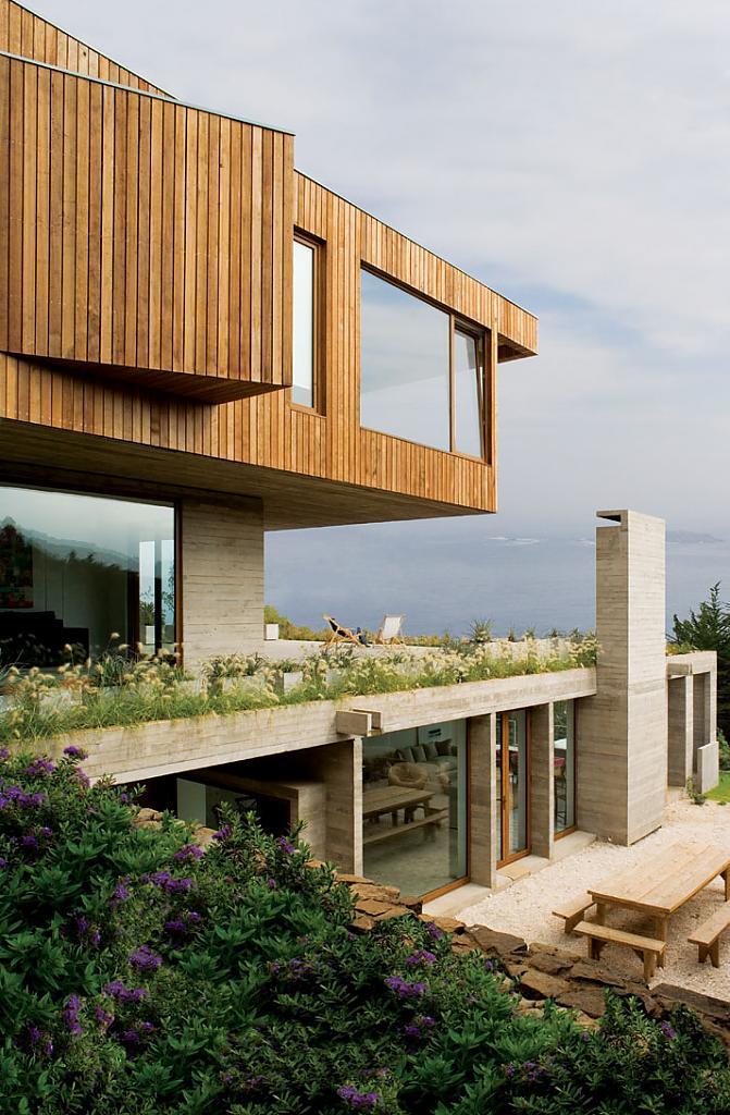 Дома на склоне холма: гармоничная отделка и вид на океан в El Pangue House