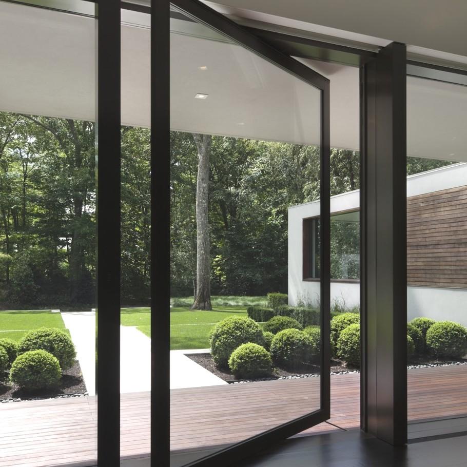 Дизайн домов США: роскошный дом с бассейном среди леса